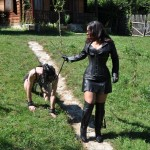 Lady Ezada Sinn with the pony slave for a morning walk