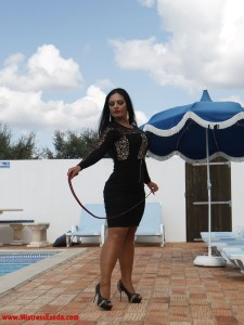 Mistress Ezada with a whip