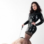 Worshipping Mistress Ezada Sinn in black latex