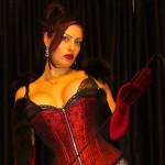 Mistress Ezada Sinn red burlesque corset and fur