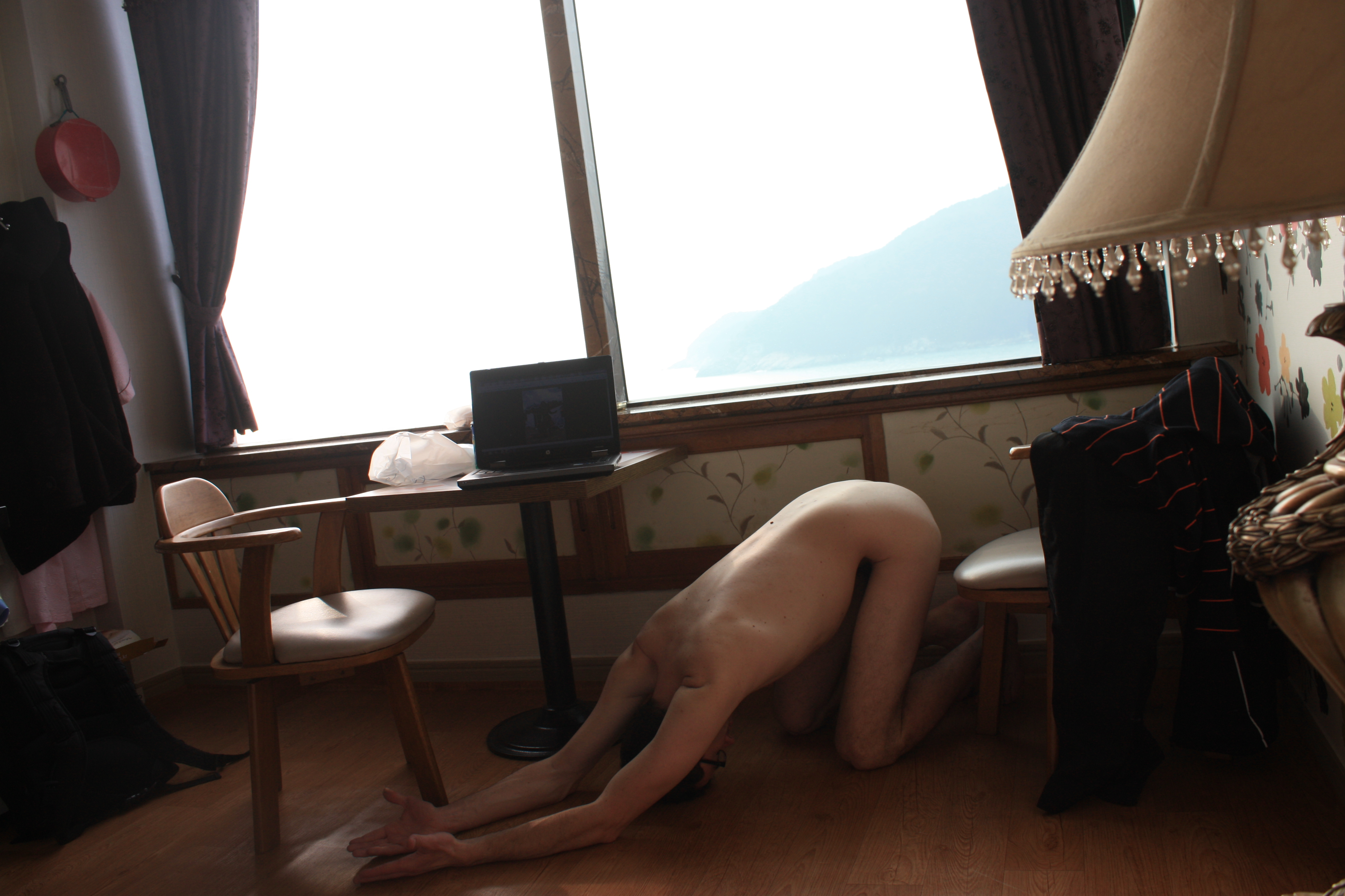 In his hotel room, slave performing the morning ritual