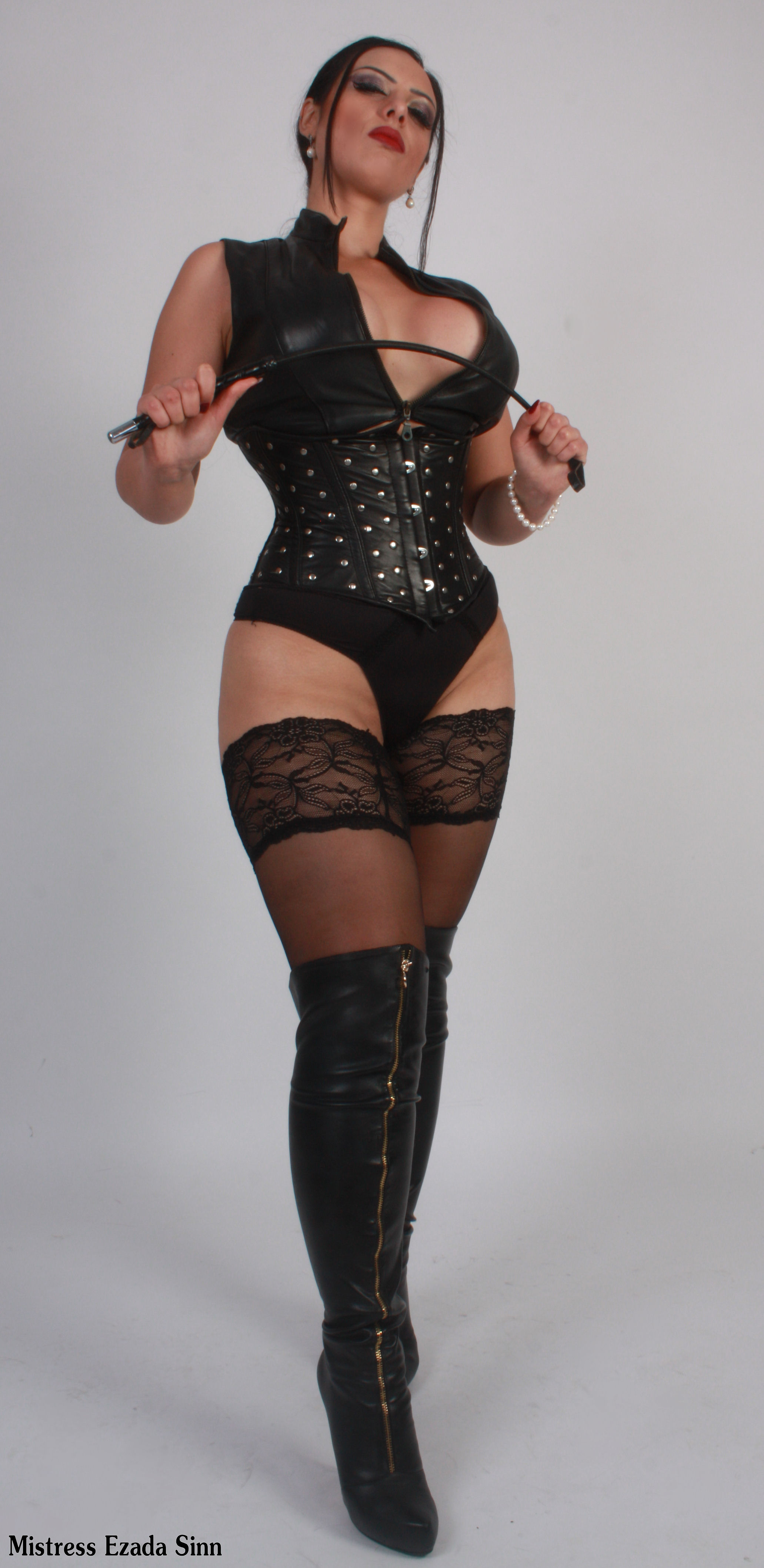 Your goddess in cruel spiked heeled leather boots and basque
