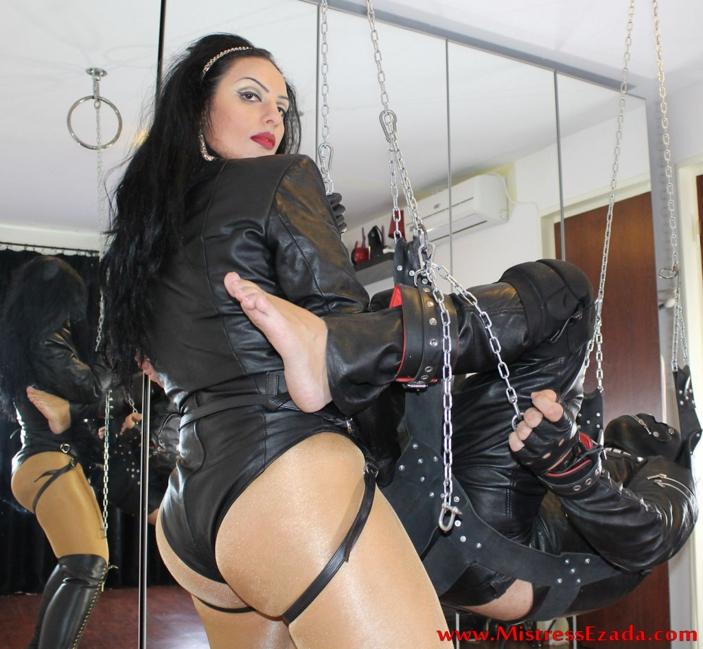 Strap-on fucking in leather