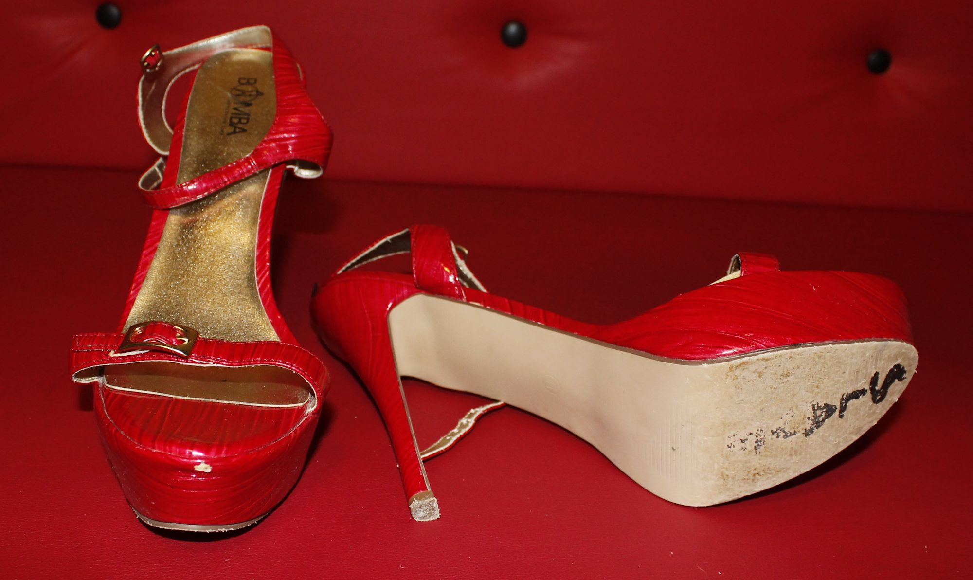 well worn red synthetic patent leather sandals - 100 euros