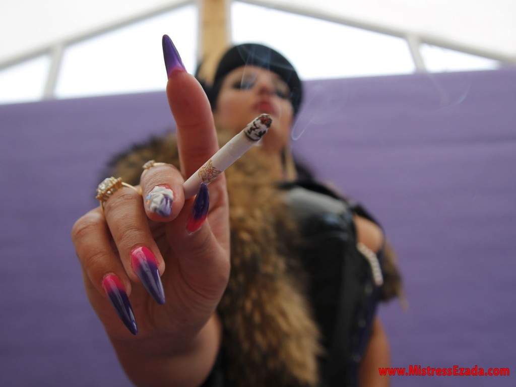 smoking human ashtray fetish long stiletto nails elegant domina