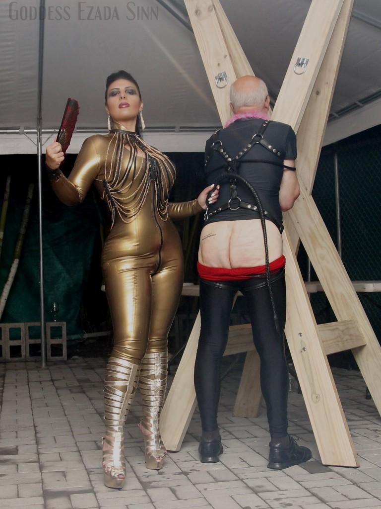Goddess Ezada Sinn golden latex slave