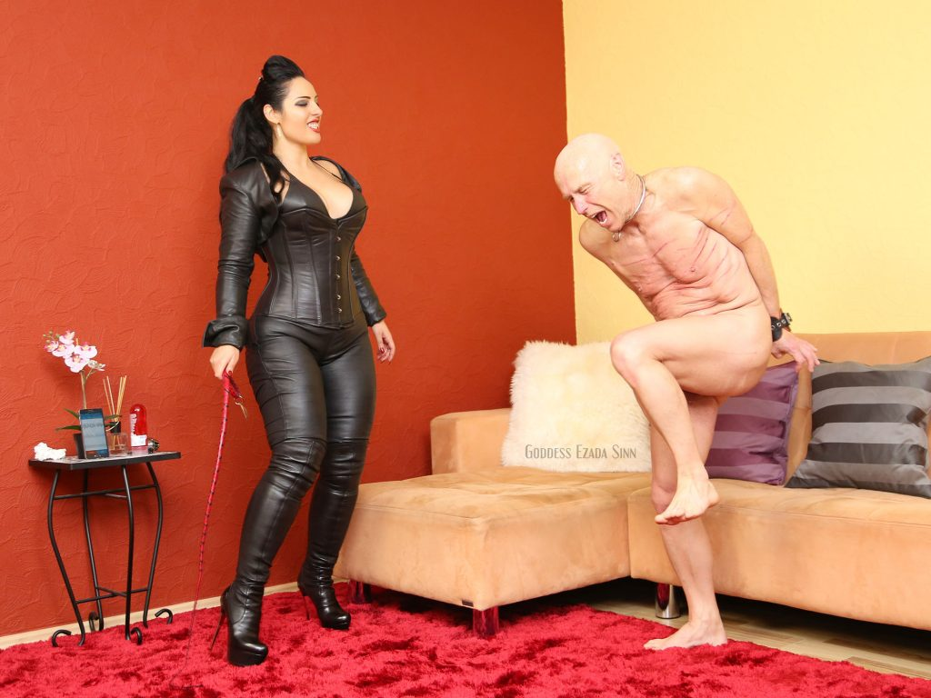 Ezada Sinn whipping leather single tail sit