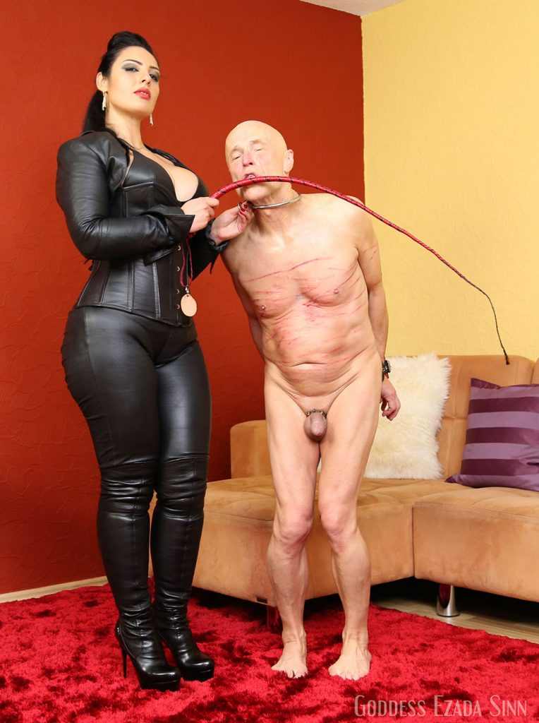After whipping leather Domina slave